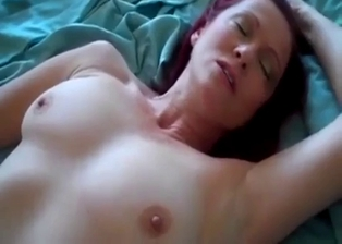 Redhead mommy gets drilled in the bedroom