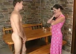 Sister in pink dress sensually sucks her brother's dick