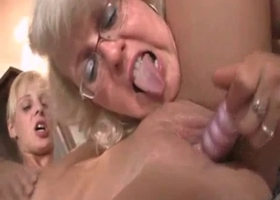 Mom licks and stimulates her daughter's shaved cunt