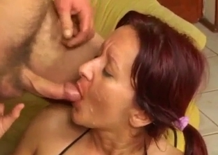 Redhead slut with huge boobs tastes her son sperm